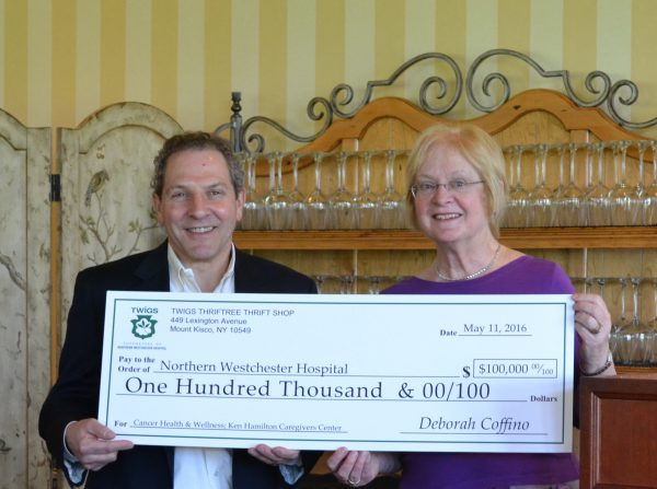 Twigs President Maureen Kilfoyle presenting the $100,000 donation to Joel Seligman, NWH president and CEO.