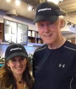 Kim Gilman and Bill Clinton wearing #ChappaCure Hats available for purchase.