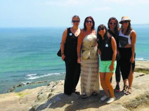Miriam (second from left) on a cliff in Morocco with new friends met on a guided tour.