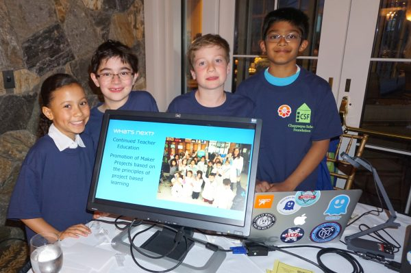 """(L-R) Mia Brown, Charlie Peterson, Teddy Meyer and Neel Roy  at """"The Maker Spaces project"""" table.  Library media specialists Christine Eidem (Roaring Brook) and Alison Turner (West Orchard) explained that the space is """"project based learning"""" with  equipment and tools for kids to build something they designed to solve a problem; and that most importantly, """"it's safe place for them to make a mistake and try again after they analyze what works. It's an outside of the box experience."""""""