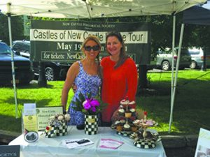 "Kimber Sanseverino (right) and Georgia Frasch at the Chappaqua Farmer's Market on May 14. ey were selling MacKenzie-Childs ra es, House Tour tickets and invites to the New Castle Historical Society's ""Clambake in Greeley's Garden"" on June 11. Visit www.newcastlehs.org for more info."