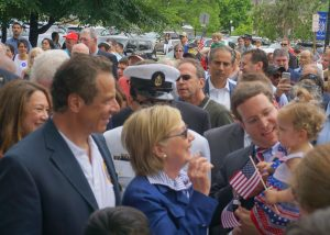 During this year's Memorial Day parade: Governor Andrew Cuomo and Secretary Clinton are tickled by Assemblyman David Buchwald's baby.  Photo by Grace Bennett