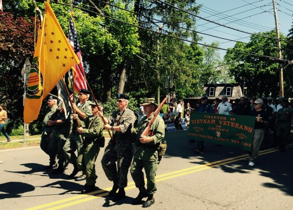 Vietnam veterans marching in the 2015 Memorial Day parade in downtown New Castle.