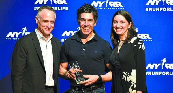 Danny Tateo (center) receiving New York Runner of the Year Award with wife, Elena (right), by his side.