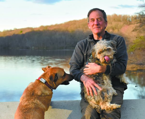 Shapera with his dogs, Ruby and Rico, on Pocantico Lake.