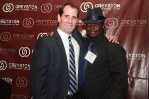 Mike Brady, President & CEO of Greyston with Greyston Bakery employee, Charles Jones