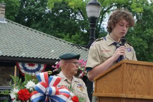 Max Auerbacher, Boy Scout Troop 2, reading an Oral History of WW II Veteran Andre Whelan
