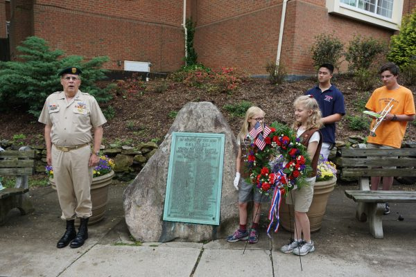 Parade Marshal: Captain James McCauley, Jr. with Holly Hulme and Charlotte LePage of Chappaqua Girl Scout Troop 2576 and members of the Horace Greeley High School Bugler