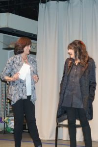 Board member Nori Fromm on stage with Reichl at the Friends of the North Castle Public Library May 4 event.