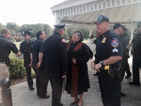Rev. Martha Jacobs greeting New Castle police officers.