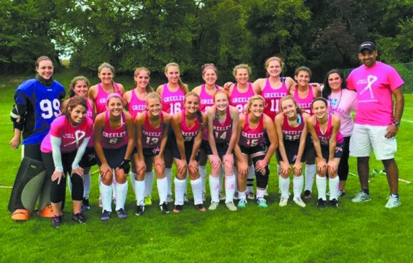 Greeley Field Hockey team wearing special pink jerseys in order to raise money for Breast Cancer research.