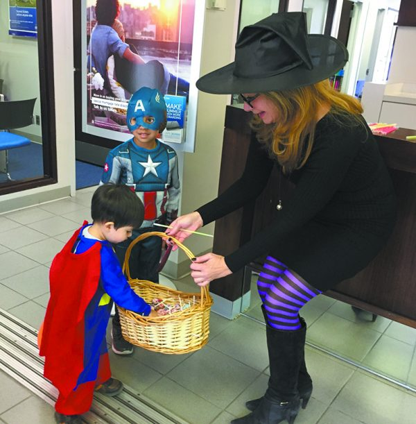 A family favorite each year. Here, Chris O'Neill at Citibank engages two trick or treaters!