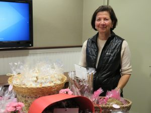 Fran Seeve managing a bake sale at the Shop for a Cause