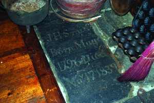 A tombstone was reused in the floor of Smith's Tavern.