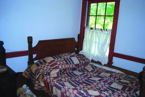 A rope bed in the bedroom of Smith's Tavern.
