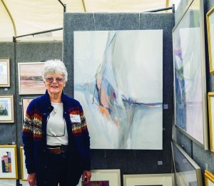 Rosalind Oesterle, an Armonk Outdoor Art Show participant since moving to Armonk the 1970s, with some of her paintings on display, on September 24, 2016. Photo © 2016 Marianne A. Campolongo.