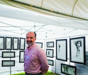 Long time Armonk Outdoor Art Show volunteer and Armonk resident Luis Perez showed his drawings for the first time at the Armonk Outdoor Art Show, on September 24, 2016. Photo © 2016 Marianne A. Campolongo.