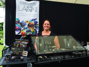 Armonk resident Lana Sidoti returned to the Armonk Outdoor Art Show for a fourth year to exhibit her bold and beautiful enameled jewelry and wall pieces, seen here on September 24, 2016. Photo © 2016 Marianne A. Campolongo.