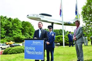 """Westchester County Executive Robert P. Astorino; Lt Col Joseph Wooley, Civil Air Patrol; Peter Scherrer, Westchester County Airport at a rededication ceremony this past July for the Lockheed T-33 jet, known as the """"T-Bird"""" after the WWII plane was restored for a year. Photos Courtesy of the Office of the Westchester County Executive"""