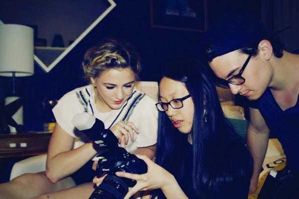 "Anna Zhang (center), reviews photos with former ""Dance Moms"" star Chloe Lukasiak."