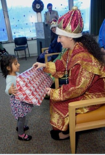 Three, Elaborately Costumed Magi Distribute Gifts to
