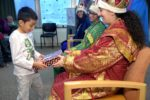 Three, Elaborately Costumed Magi Distribute Gifts to Children at Three Kings Day Celebration